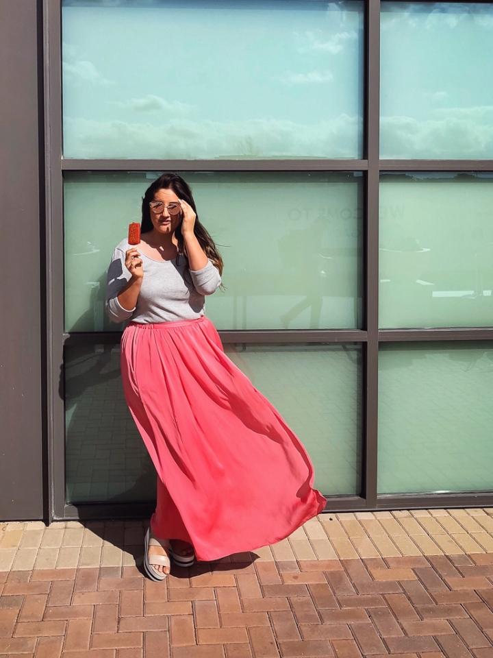 Amazon pink reflector sunglasses, Target long-sleeved off-the-shoulder Who What Wear top, Zara pink slit long skirt, Nordstrom Rack Via Spiga platform sandals, Berrynaked pop, Legacy Food Hall